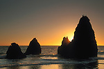 Sunset and waves against coastal rock seastack at Rodeo Beach, Marin Headlands, California