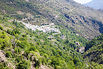 Landscape of the River Rio Poqueira gorge valley, High Alpujarras, Sierra Nevada, Granada Province, Spain whitewashed village of Pampaneria