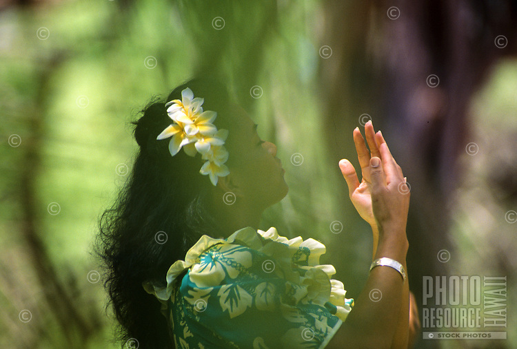 """Hula dancer performs at """"Ka Hula Piko"""" (festival), Moloka'i, Hawaii"""