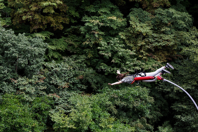 Minakami, Gunma prefecture, Japan, September 29 2016 - Beau Retallick is an Australian citizen based in Japan and the founder of Bungy Japan, a pioneer bungy jumping company in Japan. Beau Retallick is also an inventor and uses the money earned from bungy jumping to various projects. His latest invention is a jet powered drone with enough thrust to levitate a sumo wrestler.<br /> Bungy jumping at Sarugakyo bungy jumping bridge.