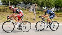 COLOMBIA. 08-08-2014. Jaime Vergara (#25) y Marco Zamprella (#68) durante la etapa 3, Barbosa – Chiquinquirá – Tunja – 123.2 Km, de la Vuelta a Colombia 2014 en bicicleta que se cumple entre el 6 y el 17 de agosto de 2014. / Jaime Vergara (#25) and Marco Zamprella (#68) cyclists during the stage 3, Barbosa – Chiquinquira – Tunja – 123.2 Km, of the Tour of Colombia 2014 in bike holds between 6 and 17 of August 2014. Photo:  VizzorImage/ José Miguel Palencia / Str