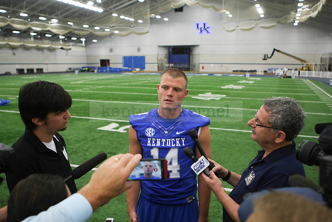 Quarterback Patrick Towles answers interview questions during UK football media day at Nutter Field House in Lexington, Ky., on Friday, August 8, 2014. Photo by Michael Reaves | Staff