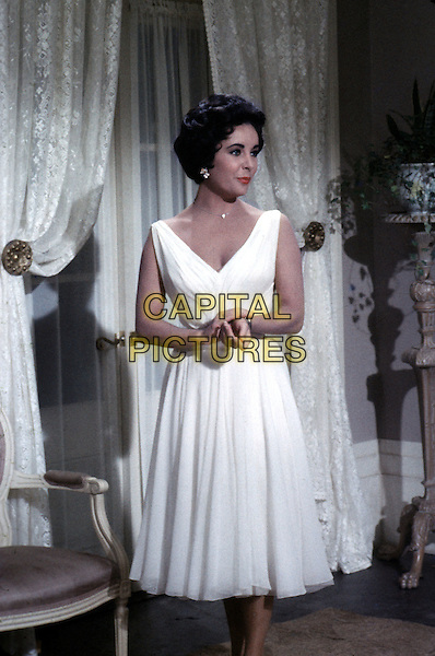 ELIZABETH TAYLOR.in Cat on a Hot Tin Roof (1958).*Filmstill - Editorial Use Only*.CAP/STF/PEL.Supplied by Capital Pictures.