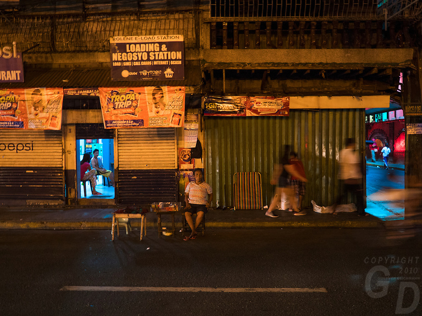 General life and environs in the Malate, Manila area and Manila Bay, Philippines. Night in Manila city.