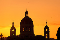 Sunset behind cupolas of Central Cathedral, Granda, Nicaragua