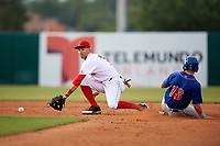 Florida Fire Frogs shortstop Alejandro Salazar (7) tries to scoop a low throw as St. Lucie Mets designated hitter Anthony Dimino (13) slides into second base during a game against the St. Lucie Mets on July 23, 2017 at Osceola County Stadium in Kissimmee, Florida.  St. Lucie defeated Florida 3-2.  (Mike Janes/Four Seam Images)