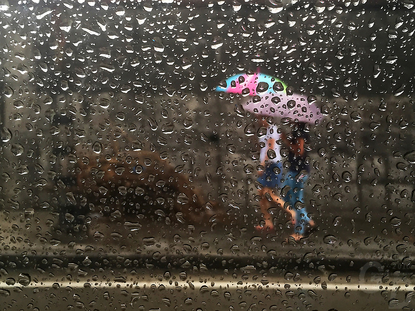 Looking out from the car window during rainy weather