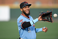 Center fielder Miguel Aparicio (5) of the Hickory Crawdads warms up before a game against the Greenville Drive on Wednesday, May 15, 2019, at Fluor Field at the West End in Greenville, South Carolina. Greenville won, 6-5. (Tom Priddy/Four Seam Images)