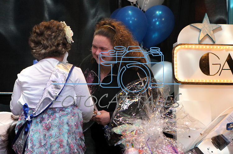 Wish-granter Christina Hurley talks with Gabby Gouldsmith, 8, as she checks out her bedroom makeover during the Make-A-Wish Foundation Waffles & Wishes event at the Atlantis Casino Resort, in Reno, Nev., on Tuesday, March 27, 2012. Gouldsmith, who suffers from an auto-immune deficiency disorder, was recognized at the event. .Photo by Cathleen Allison