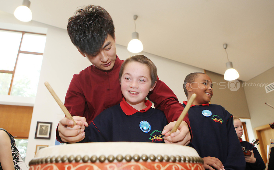 09/09/2011.Josh Dodd (10).From St Joseph's Senior School, Ballymun, Dublin  & Chineese musican  Bai Kai in traditional Chinese costume during a vist by the musicans to the school marking the official Irish visit of the Lord Mayor of Beijing, taking place this weekend.Photo: Collins