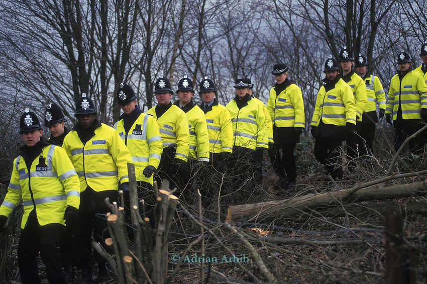 Unprecedented numbers of Police brought in to guard trees  on the  Newbury by-pass proposed route, in an effort to prevent  protesters from gaining access.