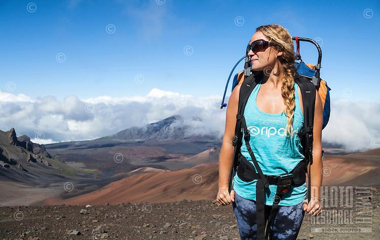A backpacker appreciates the view at Haleakala National Park, Maui.