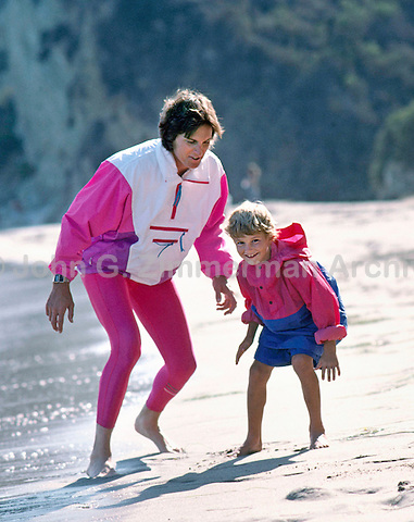 Bruce Jenner (now Caitlyn Jenner) with son Brandon, Malibu Beach, California, 1988. Photo by John G. Zimmerman