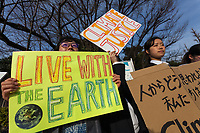 "A group of mostly young Japanese people point towards the government buildings as they take part in a demonstration as part of the ""Fridays for Future"" movement outside the National Diet Building in Tokyo, Japan. Friday February 22nd 2019. Around 30 people took part in the demonstration in which started at 3pm. The Glbal Strike for Future was started by Swedish school student, Greta Thunberg who began striking from her school to demand adults do something about climate change to ensure the furture she was studying for. Since then thousands of strikes have taken place around the world. This was the first such strike in Japan and though no school students left their schools to take part the organisers hope the Global Strike for Future on March 15th will attract many young people in Japan"