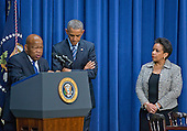 United States President Barack Obama, center, listens as he is introduced by US Representative John Lewis (Democrt of Georgia), left, prior to making remarks at a session hosted by the White House Office of Public Engagement on strengthening and protecting the right to vote at the White House in Washington, DC on Thursday, August 6, 2015. The event was attended by civil rights leaders, faith leaders, voting rights activists and state and local officials.  At right is US Attorney General Loretta Lynch.<br /> Credit: Ron Sachs / Pool via CNP