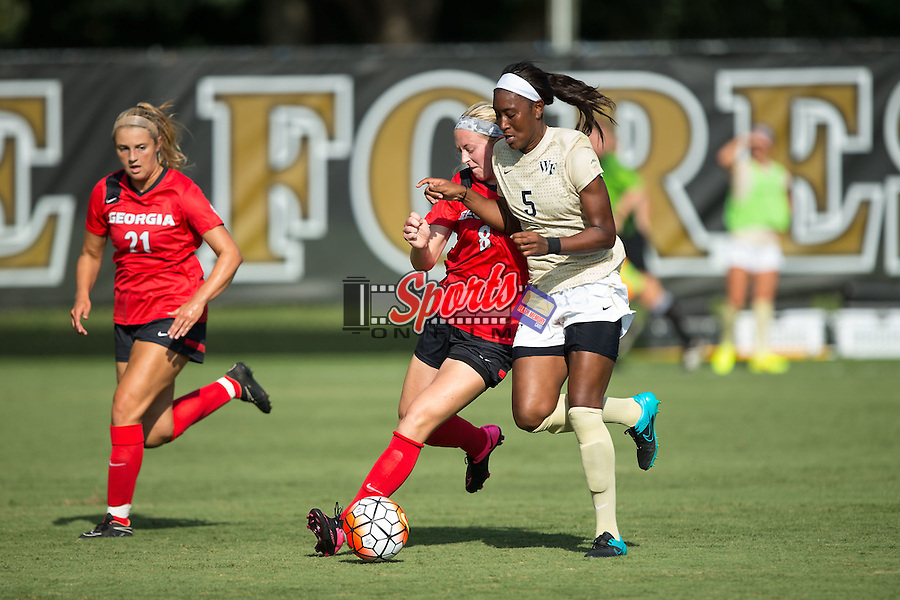 Jenai Davidson (5) of the Wake Forest Demon Deacons battles for the ball with Caroline Waters (8) of the Georgia Bulldogs at Spry Soccer Stadium on August 23, 2015 in Winston-Salem, North Carolina.  The Deacons defeated the Bulldogs 4-0.   (Brian Westerholt/Sports On Film)