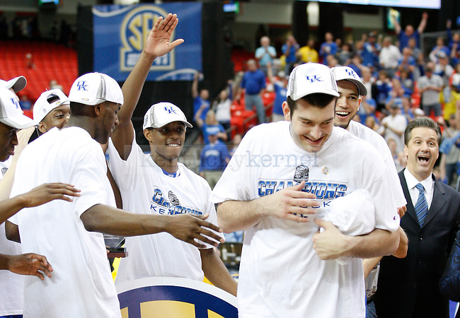 Teammates cheer as Josh Harrellson is named to the SEC All-Tournament team after the win over Florida in the championship of the .2011 SEC Tournament, played at the Georgia Dome, Sunday, March 13, 2011.  Photo by Latara Appleby | Staff