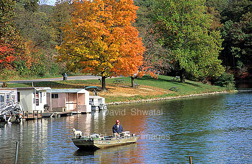 A boat cruises on rural Argyle lake near Macomb, Illinois
