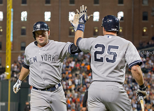 New York Yankees catcher Brian McCann (34) is congratulated by teammate Mark Teixeira (25) after hitting a go-ahead home run in the ninth inning against the Baltimore Orioles at Oriole Park at Camden Yards in Baltimore, MD on Sunday, September 14, 2014.  McCann's homer gave the Yankees a temporary 2 - 1 lead. The Orioles won the game 3 - 2.<br /> Credit: Ron Sachs / CNP<br /> (RESTRICTION: NO New York or New Jersey Newspapers or newspapers within a 75 mile radius of New York City)