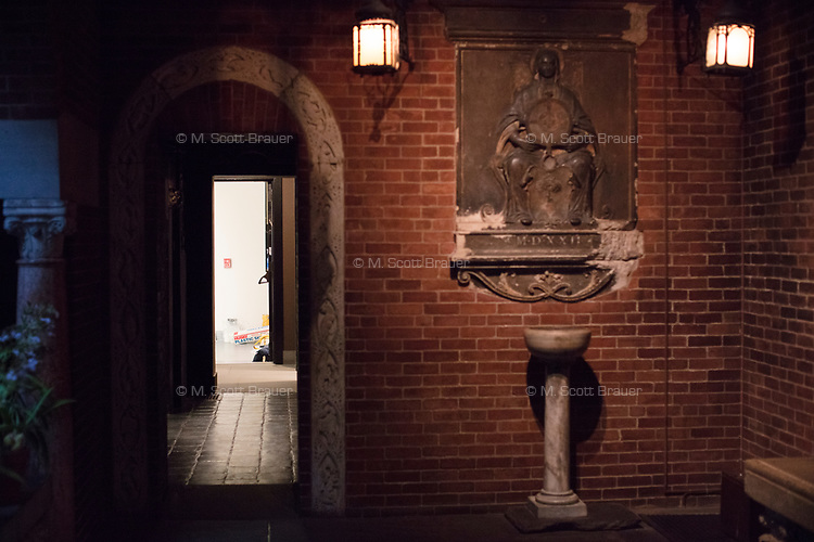 The door, at left, leading into the Courtyard area on the first floor, is where robbers entered the Isabella Stewart Gardner Museum in 1990 and stole 13 pieces of art, including paintings by Vermeer, Degas, Rembrandt, and Manet. The museum is located in Boston, Mass., USA.