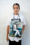 Priscila Cartagena holds a photo of her daughter Yesenia Marleni Gait&aacute;n Cartagena during a vigil in Tapachula, Mexico, on December 17, 2013. The Honduran woman was part of a group of Central Americans who came to Mexico in search of family members who disappeared there, many while on their way north to the United States. The group, mostly mothers looking for their children, spent 17 days touring 14 Mexican states in search of their loved ones.<br /> <br /> Cartagena, who lives in Tegucigalpa, says her daughter migrated north in 2008, headed to the United States, and last called her from Nuevo Laredo, Mexico. She hasn't heard from her since.
