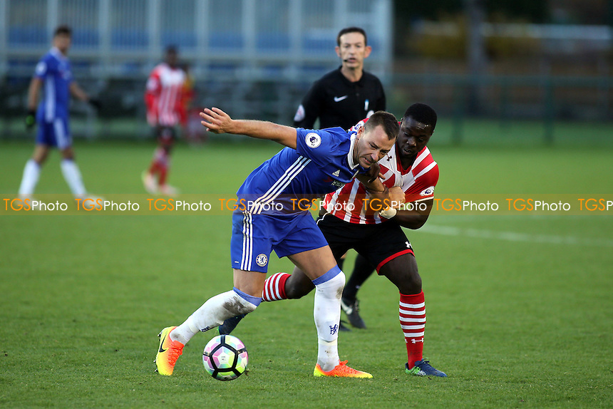 Chelsea's John Terry shields the ball from Southampton's Olufela Olomola during Chelsea Under-23 vs Southampton Under-23, Premier League 2 Football at the Cobham Training Ground on 21st November 2016
