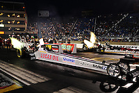Jun. 29, 2012; Joliet, IL, USA: NHRA top fuel dragster driver Chris Karamesines (near lane) races alongside Luigi Novelli during qualifying for the Route 66 Nationals at Route 66 Raceway. Mandatory Credit: Mark J. Rebilas-