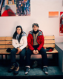 ARGENTINA, Bariloche, Cerro Cathedral, young couple sitting on a bench in ski resort