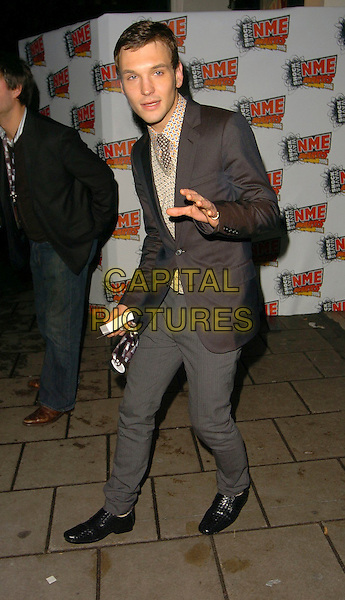 SAMUEL PRESTON.OF THE ORDINARY BOYS.At the NME Awards After Show Party, .Hammersmith Palais, London, England, .February 23rd 2006..full length sam brown suit shirt jacket tie gesture funny.Ref: CAN.www.capitalpictures.com.sales@capitalpictures.com.©Can Nguyen/Capital Pictures