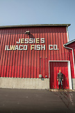 USA, Washington State, Ilwaco, the Port of Ilwaco located on the Southwest coast of Washington just inside the Columbia River bar, Jessie's Ilwaco Fish Company port worker employee and fisherman