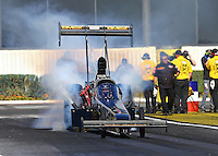 Feb 12, 2016; Pomona, CA, USA; NHRA top fuel driver Troy Buff during qualifying for the Winternationals at Auto Club Raceway at Pomona. Mandatory Credit: Mark J. Rebilas-USA TODAY Sports