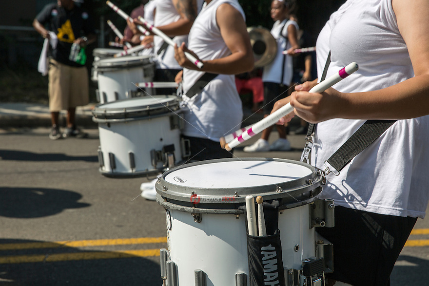 AUSTIN, TEXAS - A high school marching band drum corps plays cadence for the band while marching in the 2016 Central Texas Juneteenth Celebration Parade on Sat. June 18, 2016. <br />