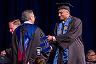 May 21, 2017; Former basketball and player Austin Torres receives his diploma from Dean Roger Huang during the Mendoza College of Business undergraduate Commencement ceremony, 2017. (Photo by Matt Cashore/University of Notre Dame)