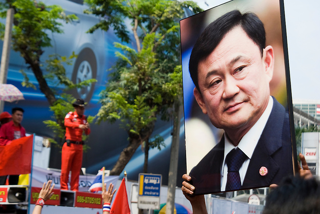 Bangkok, Jan 23: A photo of deposed leader Thaksin Shinawatra is shown to the crowd as Red Shirt loyalist speaks. United Front for Democracy against Dictatorship (UDD) Red Shirt protestors rally at Ratchapraong intersection in central Bangkok before marching to Democracy Monument. Red Shirt leaders vowed to rally two times each month to commemorate the military crackdowns on protestors last year. Bangkok, January 23, 2010.