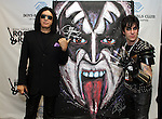 SIOUX FALLS, SD - MARCH 30: Gene Simmons from KISS and Rock Demarco pose in front of his painting that was auctioned off at the grand opening of the Brennan Rock and Roll Academy Saturday March 30, 2013 in Sioux Falls, SD. (Photo by Dave Eggen/Inertia)