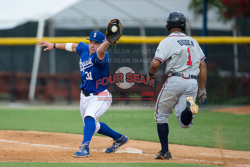 Brandon Dulin (31) of the Burlington Royals stretches for a throw as Ray-Patrick Didder (1) of the Danville Braves hustles down the first base line at Burlington Athletic Park on July 12, 2015 in Burlington, North Carolina.  The Royals defeated the Braves 9-3. (Brian Westerholt/Four Seam Images)