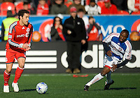 11 April 2009:  Toronto FC defender Kevin Harmse #5 and FC Dallas forward Jeff Cunningham #9 in action during an MLS game at BMO Field in Toronto between FC Dallas and Toronto FC. The game ended in a 1-1 draw.
