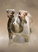 Bronze Age Anatolian terra cotta vtwo headed bull shaped ritual vessel - 19th to 17th century BC - Kültepe Kanesh - Museum of Anatolian Civilisations, Ankara, Turkey.  Against a warn art background.