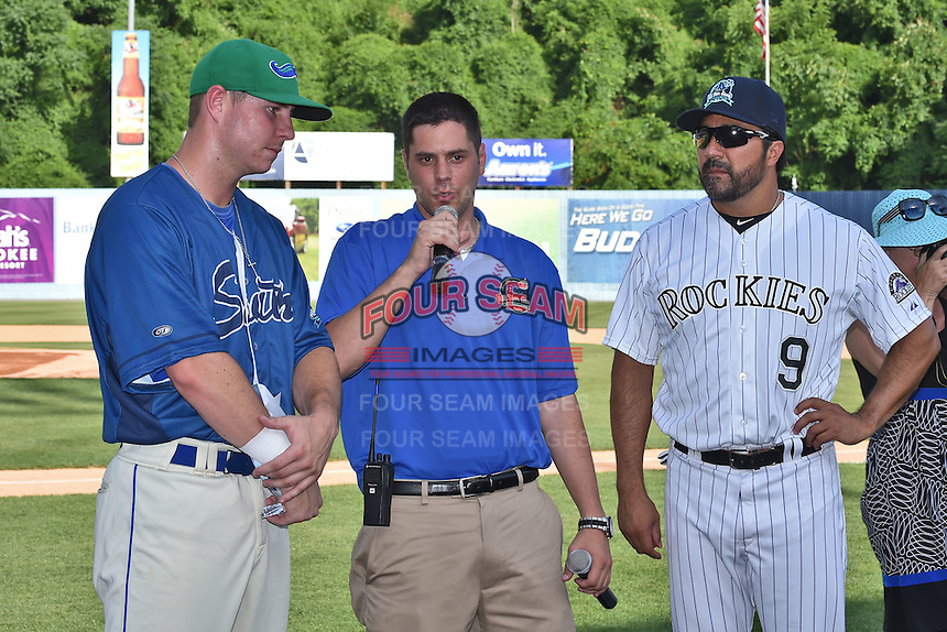 Asheville Tourists broadcast/media relations manager Doug Mauer with Vinny Castillo present trophy to Home Run Derby champion Lexington Legends infielder Ryan O'Hearn (22) after the South Atlantic League All Star Game Home Run Derby on June 23, 2015 in Asheville, North Carolina. The North Division defeated the South 7-5(Tony Farlow/Four Seam Images)