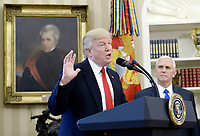 United States President Donald Trump speaks about  trade in the Oval Office of the White House, March 31, 2017 in Washington, DC. Photo Credit: Olivier Douliery/CNP/AdMedia