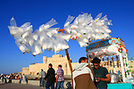 "Street vendor sell soft drinks,tea and in the plastic bag has candy floss and a small balloon for present. Bachground is the ""Qaitbey"" fort in Alexandria Egypt."