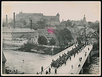BNPS.co.uk (01202 558833)<br /> Pic: Warwick&Warwick/BNPS<br /> <br /> Belgian or French prisoners being led across the Adolf Hitler bridge away from Colditz Castle in 1943.<br /> <br /> The photos show the ingenuity of the Allied POWs who devised ever-bolder ways to escape from the German stronghold during World War Two.<br /> <br /> One image is of a dummy they would hold up to trick the German guards into believing the escaper was still with them during parade head counts. Others reveal the tunnels which were dug using tools smuggled into the 11th century castle in care parcels.<br /> <br /> The photos were taken by the official Colditz photographer Johannes Lange, who was employed by the German Army to take pictures of failed Allied escape attempts. They were then distributed to other POW camps to alert the guards to the methods the inmates were using in their bids for freedom.<br /> <br /> The archive is being sold by a private collector with auctioneer Warwick & Warwick, with an estimate of £1,750.