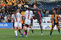David Forde of Cambridge punches clear from Jamie Collins of Sutton during Cambridge United vs Sutton United , Emirates FA Cup Football at the Cambs Glass Stadium on 5th November 2017