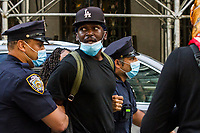 NEW YORK, NEW YORK - MAY 29: A protester is detained by the police in the anti-police protest in response to the police officer who killed George Floyd in Minneapilis in front of the Manhattan court on May 29, 2020 in New York. Across the country, protests against Floyd's death have sparked movements day and night. (Photo by Pablo Monsalve / VIEWpress via Getty Images)