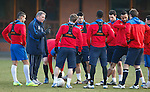 Ally McCoist gathers his Rangers players around him for a talk at training