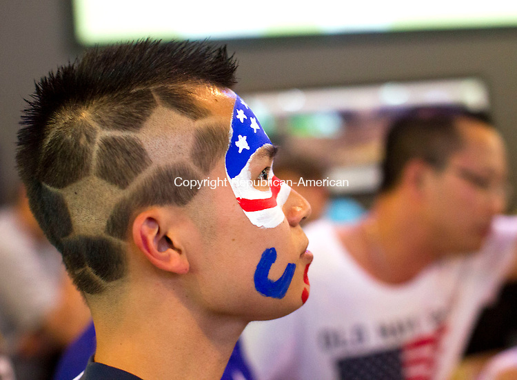 Waterbury, CT- 01 July 2014-070114CM05-  Vinh Nguyen,   of Bristol shows of his country pride as he wathces the U.S Mens soccer match against Belgium during World Cup action at Buffalo Wild Wings in Waterbury on Tuesday.    Christopher Massa Republican-American