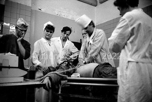 Moscow, Russia.Emergency ward.1994.Unsuccessfully trying to save a patient from a heart attak.