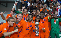 Dutch players celebrate being crowned 2018 champions during the UEFA Under-17 Championship FINAL match between Italy and Netherlands at the New York Stadium, Rotherham, England on 20 May 2018. Photo by Andy Rowland.