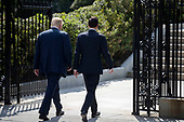 US President Donald J. Trump (L) and Secretary of Treasury Steven Mnuchin (R) walk to the White House after a financial services Executive Order signing ceremony at the Treasury Department in Washington, DC, USA, 21 April 2017. President Trump is making his first visit to the Treasury Department for a memorandum signing ceremony with Secretary Mnuchin.<br /> Credit: Shawn Thew / Pool via CNP