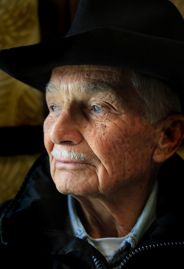 "Retired Parker Ranch manager and cowboy, Jamie Dowsett, 85, who spent most of his life on horses and has rich stories to tell, is photographed at his home in Waimea, Hi.  ""I'm 85 years old and I still think that cows and horses are the best things that ever walked on earth.  I would give anything if I could still be a cowboy...being out there on the land where nobody bothers you, out in the open where it's quiet...the horses are giving you a wonderful ride in the beautiful countryside...that is a feeling not many people have the opportunity to experience,"" says Dowsett wistfully."